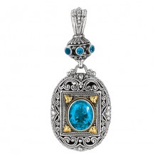 18kt Yellow Gold and Sterling Silver Oxidized Oval Blue Topaz Byzantine Pendant.